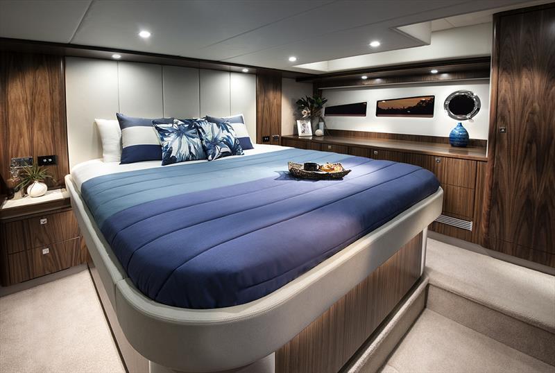 Hull windows bathe the luxurious master stateroom in natural light on the Riviera 5400 Sport Yacht. - photo © Riviera Australia