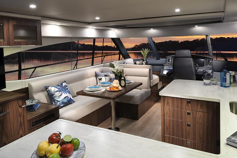 Stylish saloon and gourmet galley of the Riviera 5400 Sport Yacht. - photo © Riviera Australia