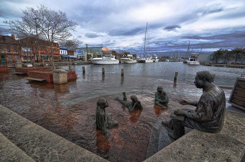 Sea level rise above the city's existing sea walls regularly floods the City Dock in Annapolis, Maryland. - photo © Amy McGovern