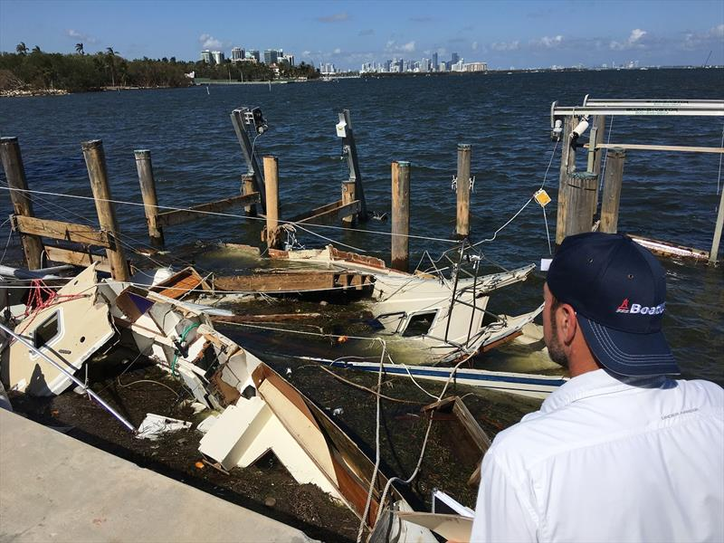 Learn what these guys know about how to protect a boat during a hurricane. Here a member of the BoatUS Catastrophe Team arranges for salvage of wrecked boats after hurricane Irma. photo copyright Scott Croft taken at  and featuring the Marine Industry class