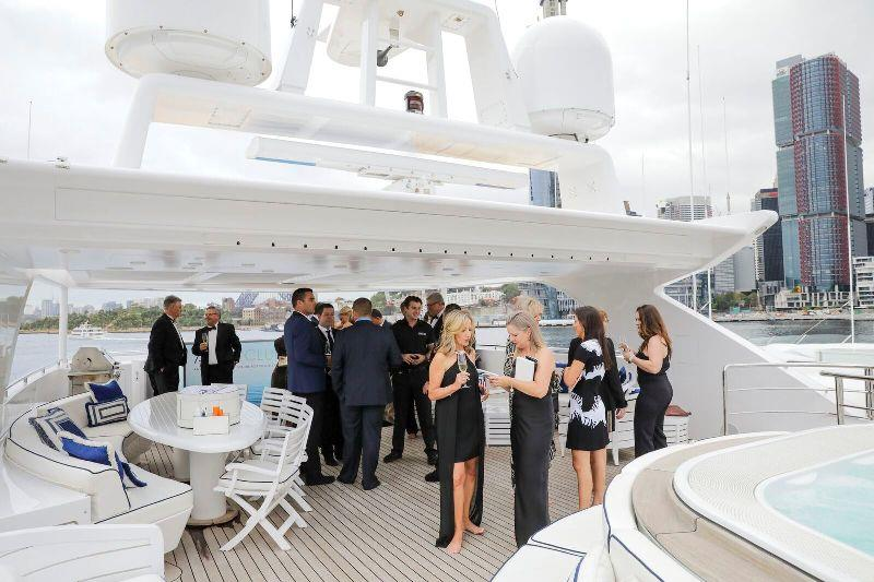VIPs being treated to champagne onboard Ahoy Club's MY Mischief, Australia's largest domestic charter vessel. - photo © AIMEX