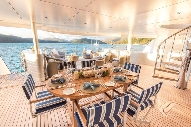 M/Y Spirit table set up on deck  - photo © Spirit Luxury Charters