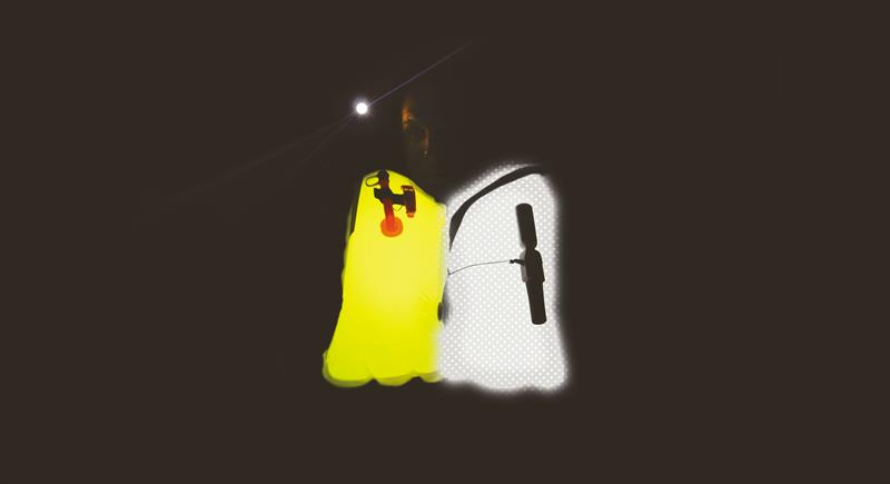 Concept visual showing extra thermoplastic layer containing retro reflective particles versus normal high visibility bladder material - photo © Spinlock